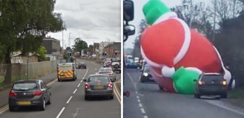Giant inflatable Santa causes traffic chaos as it blocks main road ahead of town's royal visit from Prince Charles