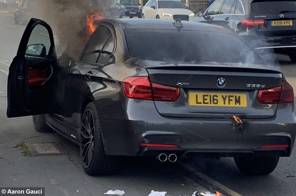 Firefighter's BMW making 'strange noise' bursts into flames while he