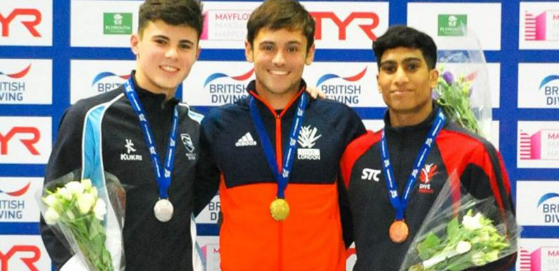 Tom Daley scores top marks at British National Diving Cup in front of new baby Robbie, husband Lance and sell-out Plymouth crowd