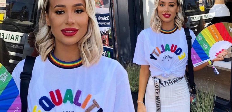 Demi Sims commands attention as she cuts slim figure in rainbow t-shirt while attending gay pride festival in Manchester