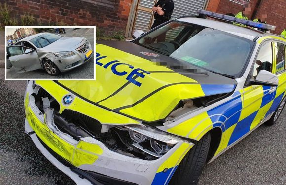 Driver of stolen car smashes into and ruins top of the range BMW police car during high-speed pursuit through Greater Manchester