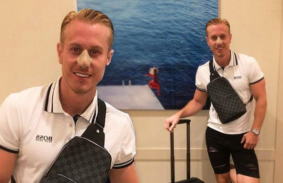Kris Boyson is all smiles as he shows off his 'half price nose job' partner Katie Price bagged him during trip to Istanbul for her facelift