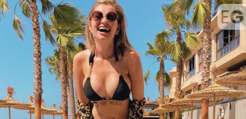 Amy Hart all smiles as she flaunts her ample assets in bikini