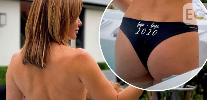 Amanda Holden welcomes the New Year topless in hot tub
