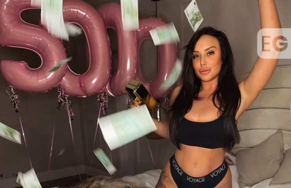 Charlotte Crosby poses in bed of cash for Instagram giveaway