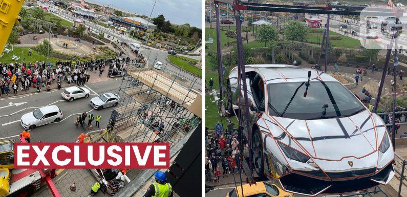 Custom Lamborghini hoisted into VIP club by crane